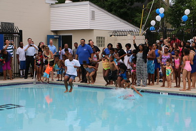 After honoring the hard work of board members and community volunteers, the children and their families gathered around to jump into the pool together at the George Washington Carver Center, June 20, 2015