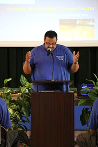 Pastor Byron Craig, head of the George Washington Carver Center board, welcomes the community members who have gathered to celebrate the opening of the Center's pool. The pool has been re-opened after years of insufficient funding, which caused the pool to be closed to the community, June 20, 2015
