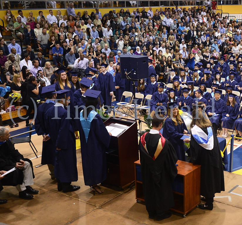 . Graduates come up from their seats to receive their diplomas.  Thursday, June 12, 2014.  Photo by Adrianna Hoff/Times Herald Staff.