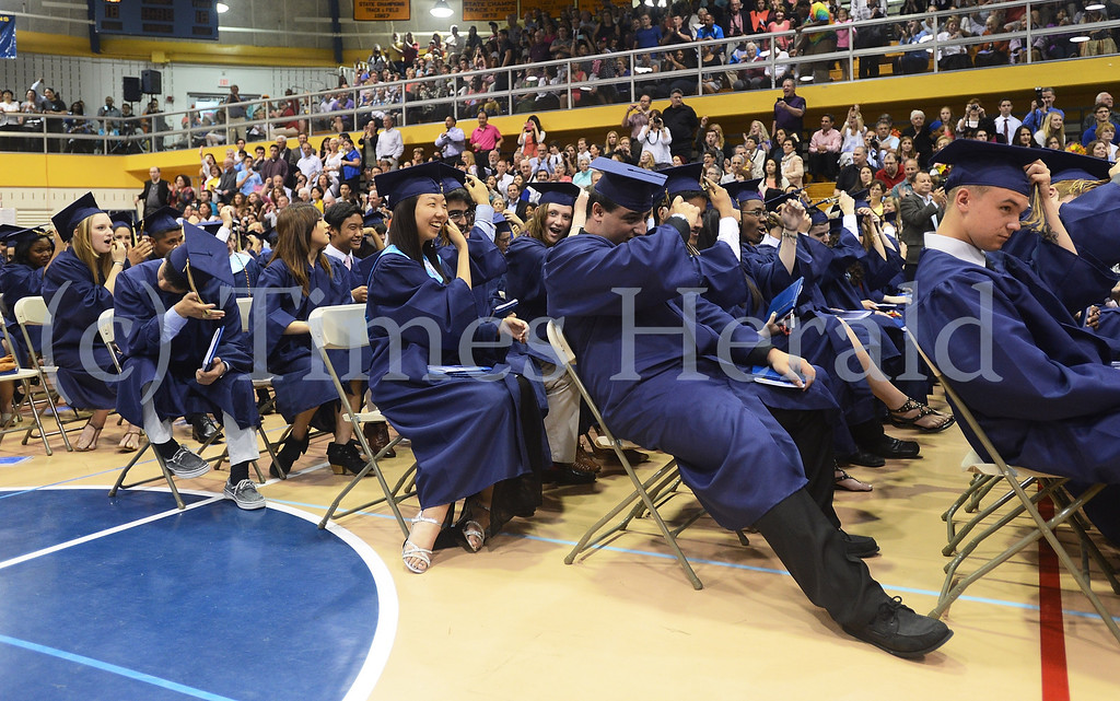 . As the ceremony comes to a close, graduates move their tassles from the right side to the left.  Thursday, June 12, 2014.  Photo by Adrianna Hoff/Times Herald Staff.
