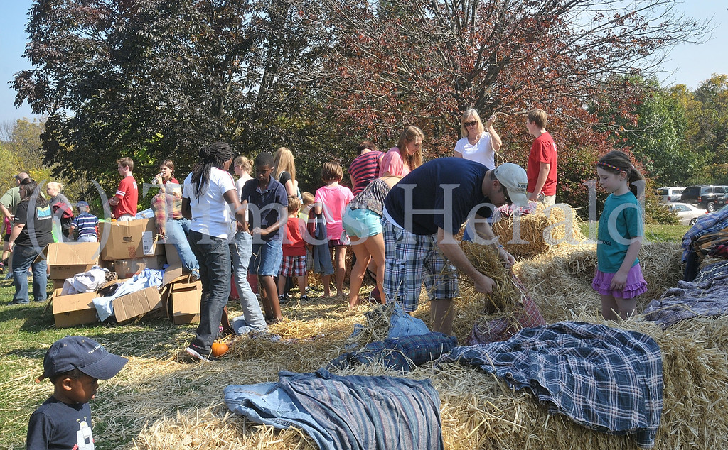 . Visitors made their own scarecrows at the Lower Providence Fall Festival.  Saturday, October 5, 2013.  Photo by Adrianna Hoff/Times Herald Staff.