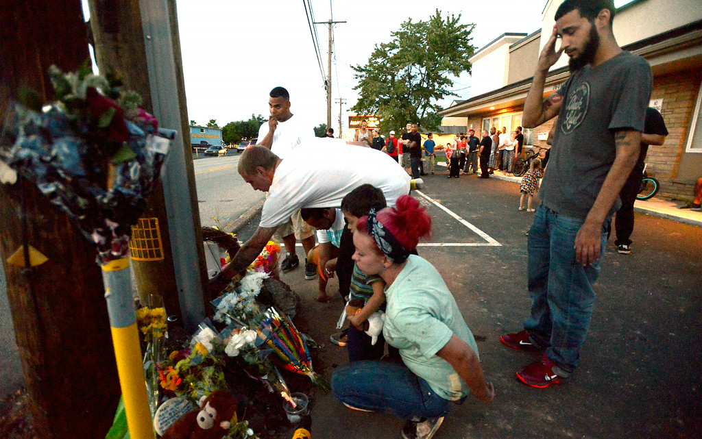 . Mourners gather Monday night, Aug. 25, 2014 at the site of a fatal accident along Broad St., Hatfield. Montgomery Media staff photo by Bob Raines