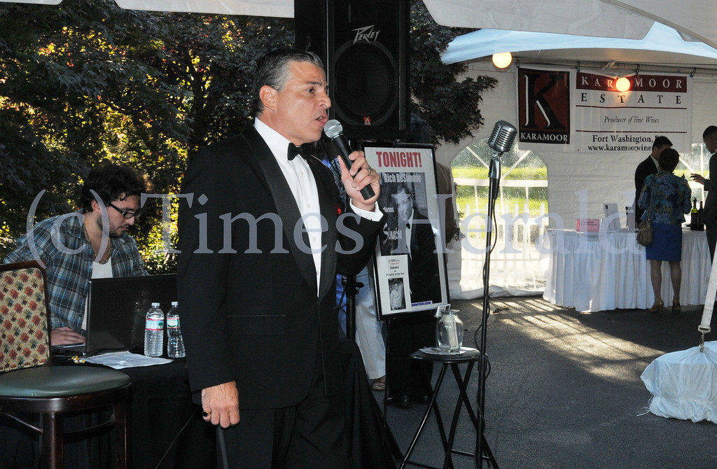 . Rich DeSimone sings songs by Sinatra for the crowd during the 13th Annual International Food and Wine Extravaganza at the Plymouth Country Club.  Thursday, September 5, 2013.  Photo by Adrianna Hoff/Times Herald Staff.