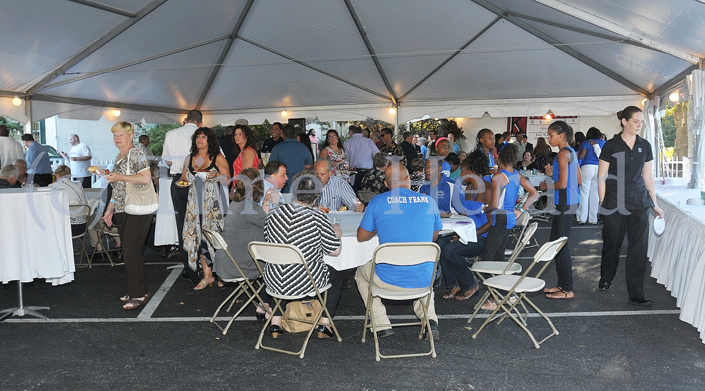 . The GNPAL\'s International Food and Wine Festival heats up under the tent at the Plymouth Country Club.  Thursday, September 5, 2013.  Photo by Adrianna Hoff/Times Herald Staff.
