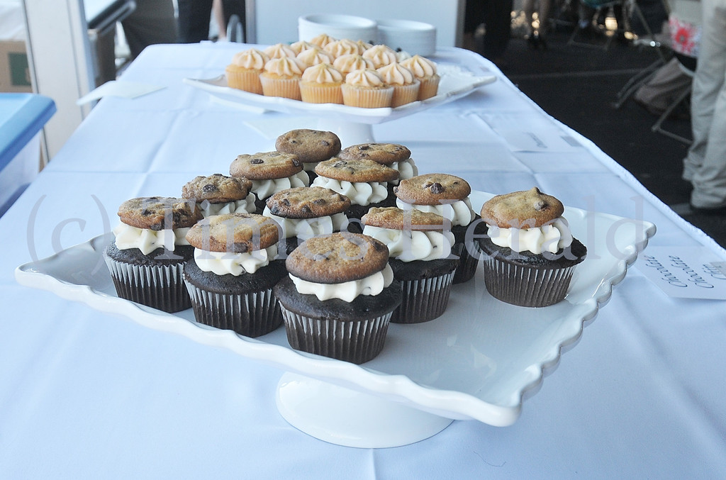 . Part of V\'s Cupcakes Display at the 13th Annual International Food and Wine Festival at the Plymouth Country Club.  Thursday, September 5, 2013.  Photo by Adrianna Hoff/Times Herald Staff.