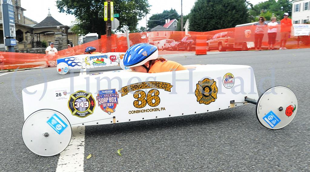 . Elizabeth Maxwell races down Fayette Street.  Friday, July 4, 2014.  Photo by Adrianna Hoff/Times Herald Staff.