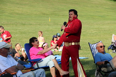 Local Elvis Presley impersonator, Dean Garofolo, serenades crowd members with classic Elvis songs, costumes, and dance moves at Norristown Farm Park, June 7, 2015