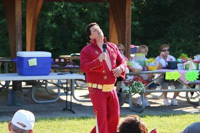 Paul and Phyllis Greco raise money for the Susan G. Komen 3-Day Walk For the Cure by holding a concert in Norristown Farm Park. Local Elvis Presley impersonator, Dean Garofolo, entertained the crowd with dozens of classic songs and dance moves, June 7, 2015. Photos for the Times Herald by Alexis Primavera.