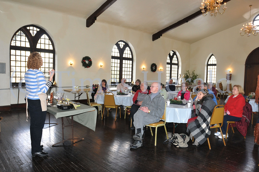 . Zwahlen\'s Melanie Low talks about the history of chocolate to visitors to Christ Church of Swedesberg. Saturday, March 8, 2014.  Photo by Adrianna Hoff/Times Herald Staff.