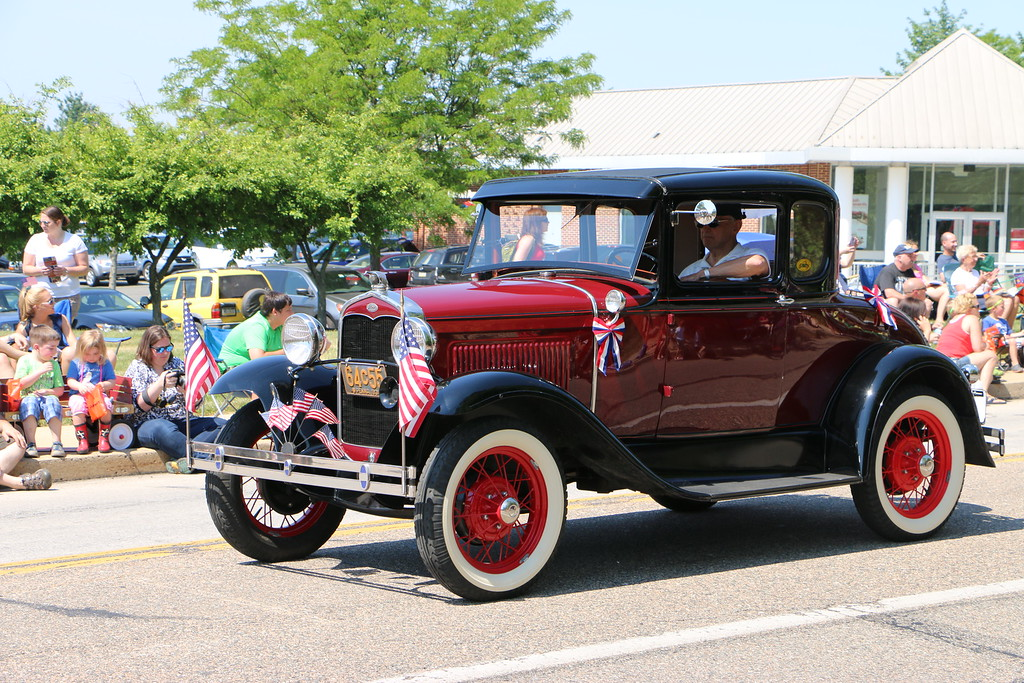 . Dozens of antique cars and trucks carrying veterans made there way along the parade route, which began at Augustus Lutheran Church and ended at Water Works Park.