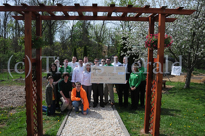 Area Wegmans representative help in restoring the Pathway School's vegetable garden Thursday, Ma 7, 2014