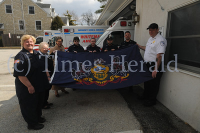 Pa. State Rep. Mary Jo Daley presents a Pa. State Flag to Whitemarsh Community Ambulance Association in recognition of it's expanded community service March 20, 2014. Photo by Gene Walsh / Times Herald Staff