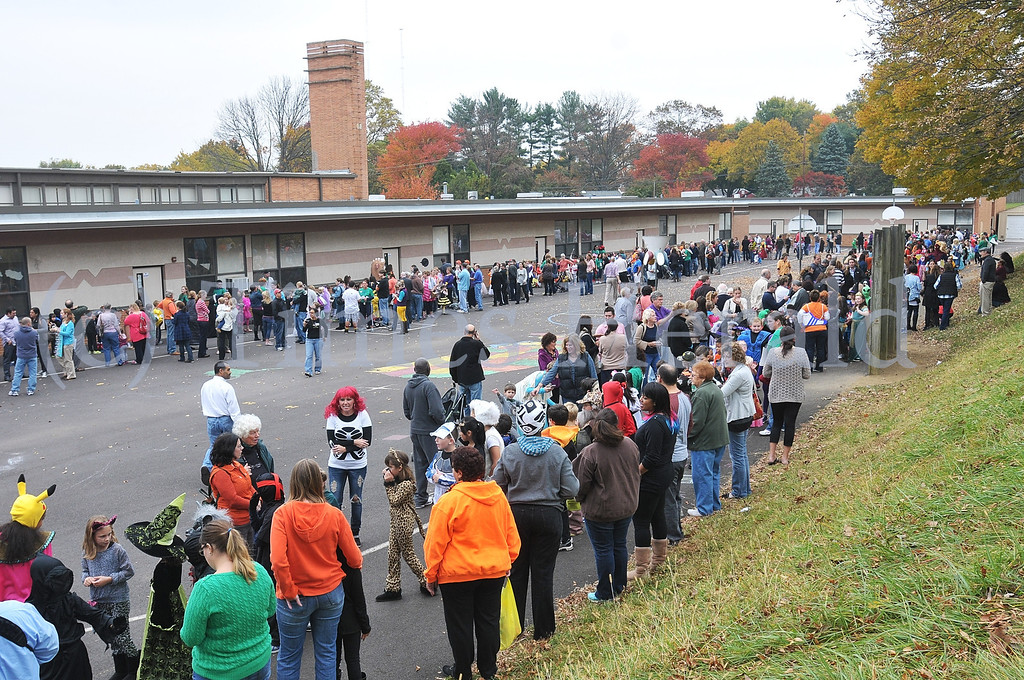 . Students, teachers, and parents gather for Whitemarsh Elementary\'s annual Halloween Parade.  Thursday, October 31, 2013.  Photo by Adrianna Hoff/Times Herald Staff.