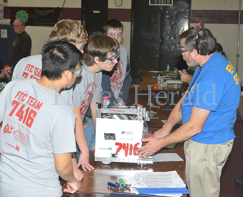 . Teams have their robots checked by staff before the start of the FIRST® Robotics Eastern Regional Qualifier, held at Montgomery County Community College.  Saturday, December 7, 2013.  Photo by Adrianna Hoff/Times Herald Staff.
