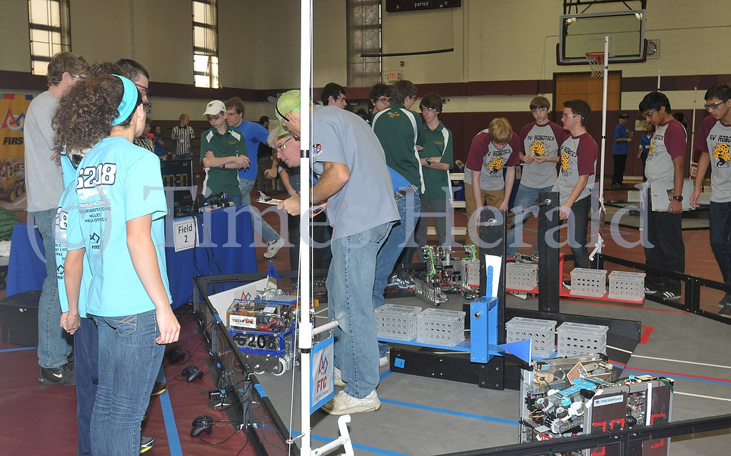 . Teams compete in the  FIRST® Robotics Eastern Regional Qualifier held at the Physical Education Building of Montgomery County Community College.  Saturday, December 7, 2013.  Photo by Adrianna Hoff/Times Herald Staff.