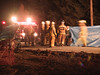 Firefighters investigate the scene of an accident in Montgomery Twp., PA