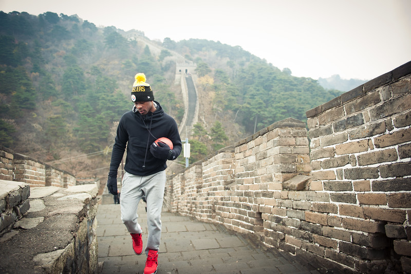 November 18, 2015 - NFL China Pittsburgh Steelers Super Bowl XLIII Champions Tour. Ike Taylor climbs the Great Wall of China.