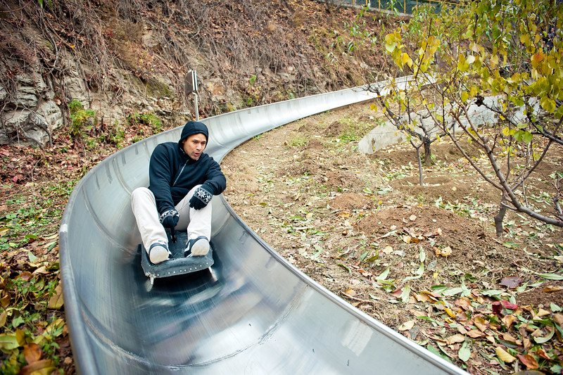 November 18, 2015 - NFL China Pittsburgh Steelers Super Bowl XLIII Champions Tour. Troy Polamalu speeds down the Great Wall of China on a toboggan sled.