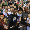 Ryan Clark takes a group selfie with Skyway football clinic kids at NFL Home Field, Shanghai.