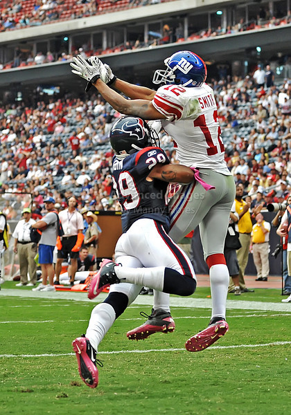 Oct 10 2010:  <br /> New York Giants wide receiver Steve Smith #12 leaps in the air in the end zone and makes a great catch for a touchdown as Houston Texans cornerback Glover Quin #29 defends in a game between New York Giants and the Houston Texans at Reliant Stadium in Houston, Texas.<br /> New York Giants win 34-10.<br /> (Credit Image: © Manny Flores/Cal Sport Media)