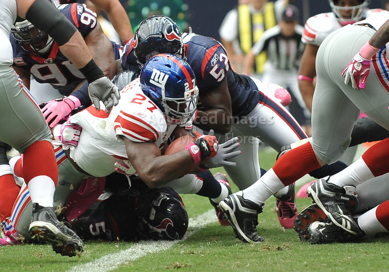 10 Oct 2010:  <br /> New York Giants running back Brandon Jacobs #27 dives in the endzone for a touchdown in a game between the New York Giants and the Houston Texans at Reliant Stadium in Houston Texas.<br /> Giants win 34-10