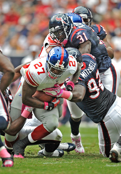 Oct 10 2010:  <br /> New York Giants running back Brandon Jacobs #27 carries the ball for a first down in a game between New York Giants and the Houston Texans at Reliant Stadium in Houston, Texas.<br /> New York Giants win 34-10.<br /> (Credit Image: © Manny Flores/Cal Sport Media)