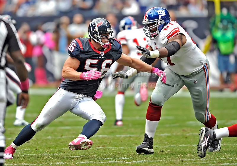 10 Oct 2010:  <br /> Houston Texans linebacker Brian Cushing #56 tries to run around New York Giants offensive tackle Kareem McKenzie #67 <br /> in a game between the New York Giants and the Houston Texans at Reliant Stadium in Houston Texas.<br /> Giants win 34-10