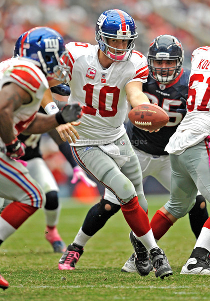 10 Oct 2010:  <br /> New York Giants quarterback Eli Manning #10 turns around to hand off the ball in a game between the New York Giants and the Houston Texans at Reliant Stadium in Houston Texas.<br /> Giants win 34-10