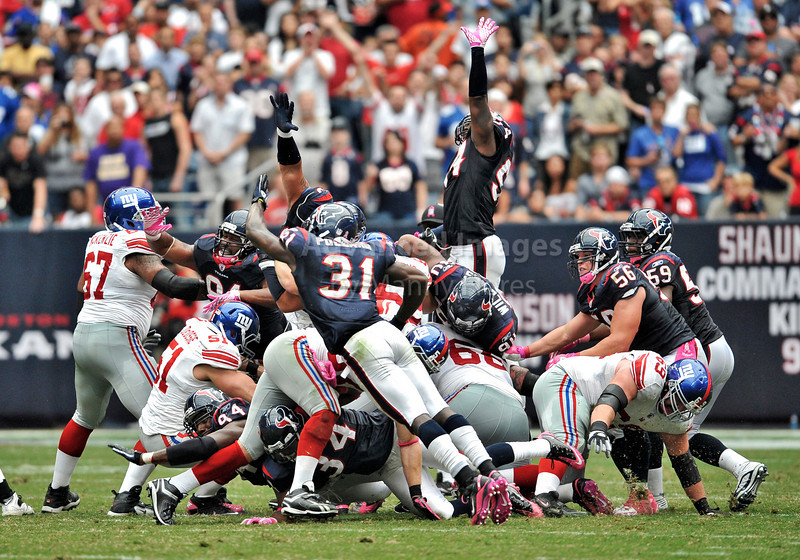 10 Oct 2010:  <br /> Houston Texans safety Bernard Pollard #31 and Houston Texans linebacker Zac Diles #54 try to block a field goal attempt<br /> in a game between the New York Giants and the Houston Texans at Reliant Stadium in Houston Texas.<br /> Giants win 34-10