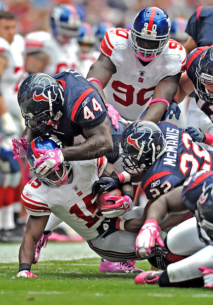 10 Oct 2010:  <br /> New York Giants running back Darius Reynaud #15 runs into a wall with Houston Texans fullback Vonta Leach #44 leading the way<br /> in a game between the New York Giants and the Houston Texans at Reliant Stadium in Houston Texas.<br /> Giants win 34-10
