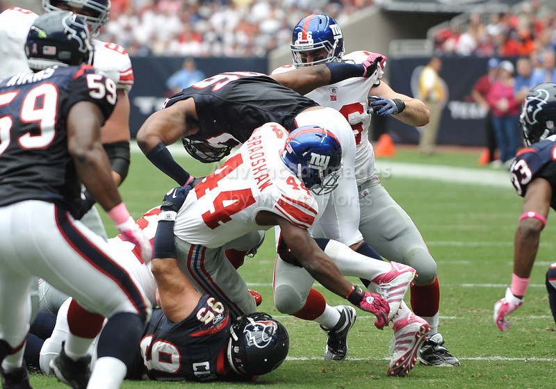 Oct 10 2010:  <br /> New York Giants running back Ahmad Bradshaw #44 carries the ball as Houston Texans defensive tackle Shaun Cody #95 makes the tackle in a game between New York Giants and the Houston Texans at Reliant Stadium in Houston, Texas.<br /> New York Giants win 34-10.<br /> (Credit Image: © Manny Flores/Cal Sport Media)