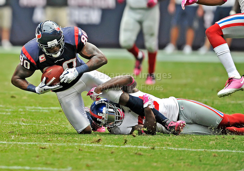 10 Oct 2010:  <br /> Houston Texans wide receiver Andre Johnson #80 catches the ball as New York Giants safety Antrel Rolle #26 defends in a game between the New York Giants and the Houston Texans at Reliant Stadium in Houston Texas.<br /> Giants win 34-10