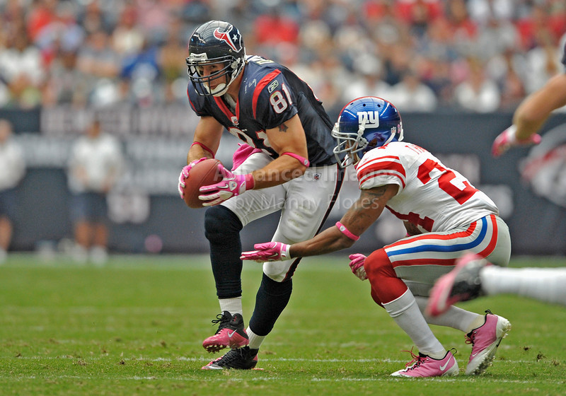 10 Oct 2010:  <br /> Houston Texans tight end Owen Daniels #81 catches the ball as New York Giants cornerback Terrell Thomas #24 causes a fumble<br /> in a game between the New York Giants and the Houston Texans at Reliant Stadium in Houston Texas.<br /> Giants win 34-10