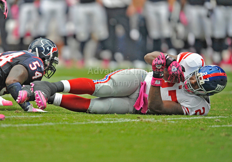 10 Oct 2010:  <br /> New York Giants running back Brandon Jacobs #27 is knocked down after he gets a first down in a game between the New York Giants and the Houston Texans at Reliant Stadium in Houston Texas.<br /> Giants win 34-10