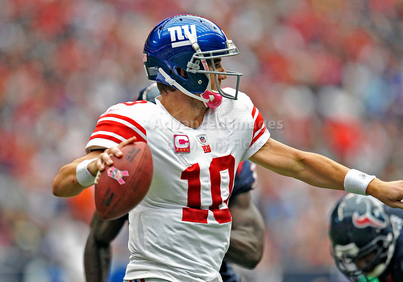 10 Oct 2010:  <br /> New York Giants quarterback Eli Manning #10 sets to pass<br /> in a game between the New York Giants and the Houston Texans at Reliant Stadium in Houston Texas.<br /> Giants win 34-10.