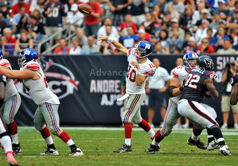 Oct 10 2010:  <br /> New York Giants quarterback Eli Manning #10 passes the ball<br /> in a game between New York Giants and the Houston Texans at Reliant Stadium in Houston, Texas.<br /> New York Giants win 34-10.<br /> (Credit Image: © Manny Flores/Cal Sport Media)