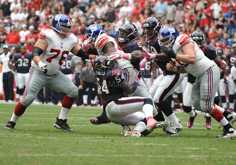 10 Oct 2010:  <br /> New York Giants running back Ahmad Bradshaw #44 bulls his way as Houston Texans linebacker Zac Diles #54 makes a tackle<br /> in a game between the New York Giants and the Houston Texans at Reliant Stadium in Houston Texas.<br /> Giants win 34-10