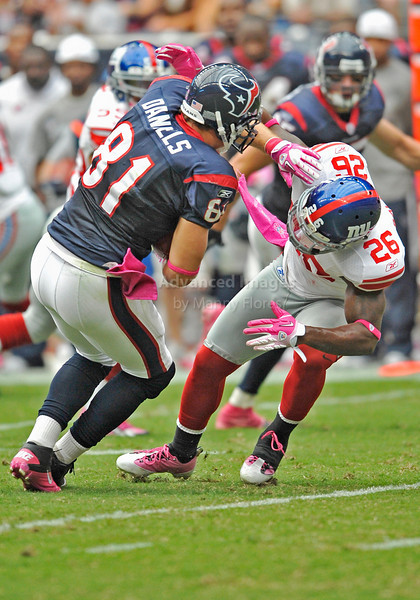 Oct 10 2010:  <br /> Houston Texans tight end Owen Daniels #81 catches the ball and lowers his head to get a first down as New York Giants safety Antrel Rolle #26 makes the tackle in a game between New York Giants and the Houston Texans at Reliant Stadium in Houston, Texas.<br /> New York Giants win 34-10.<br /> (Credit Image: © Manny Flores/Cal Sport Media)
