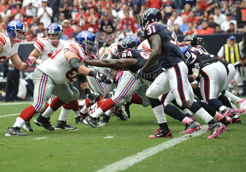 10 Oct 2010:  <br /> New York Giants guard Rich Seubert #69 and Houston Texans defensive end Antonio Smith #94 go at each other<br /> in a game between the New York Giants and the Houston Texans at Reliant Stadium in Houston Texas.<br /> Giants win 34-10