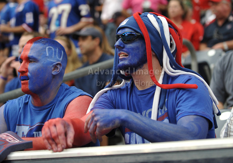 10 Oct 2010:  <br /> New York Giants fans cheer for their team<br /> in a game between the New York Giants and the Houston Texans at Reliant Stadium in Houston Texas.<br /> Giants win 34-10