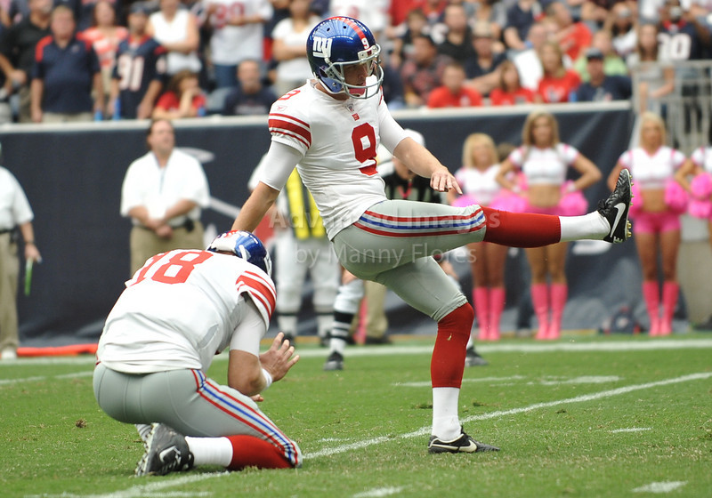 10 Oct 2010:  <br /> New York Giants place kicker Lawrence Tynes #9 kicks a field goal<br /> in a game between the New York Giants and the Houston Texans at Reliant Stadium in Houston Texas.<br /> Giants win 34-10