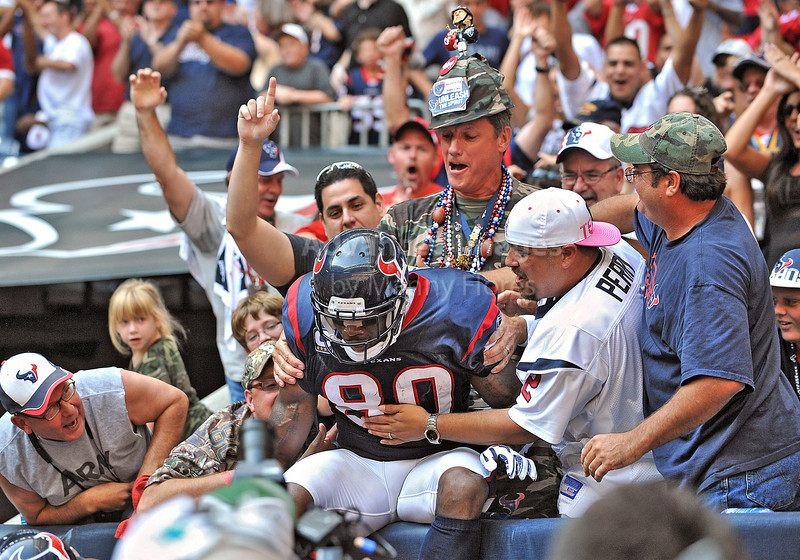 17 Oct 2010:  <br /> Houston Texans wide receiver Andre Johnson #80 celebrates with the fans after getting the winning touchdown with less than a minute to go<br /> in a game between the Kansas City Chiefs and the Houston Texans at Reliant Stadium in Houston, Texas.<br /> Houston wins 35-31