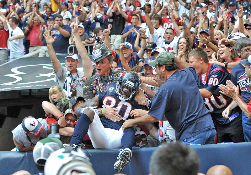Oct 17 2010:  <br /> Houston Texans wide receiver Andre Johnson #80 jumps into the excited fans seats after he catches the winning touchdown with less than a minute to play in a game between Kansas City Chiefs and the Houston Texans at Reliant Stadium in Houston, Texas.<br /> Houston wins 35-31<br /> (Credit Image: © Manny Flores/Cal Sport Media)