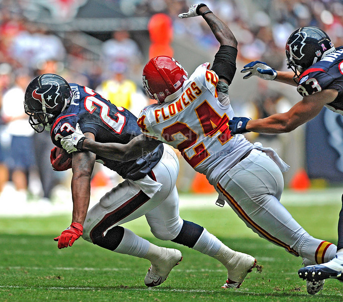 17 Oct 2010:  <br /> Houston Texans running back Arian Foster #23 carries the ball as he is tackled by Kansas City Chiefs cornerback Brandon Flowers #24<br /> in a game between the Kansas City Chiefs and the Houston Texans at Reliant Stadium in Houston, Texas.<br /> Houston wins 35-31