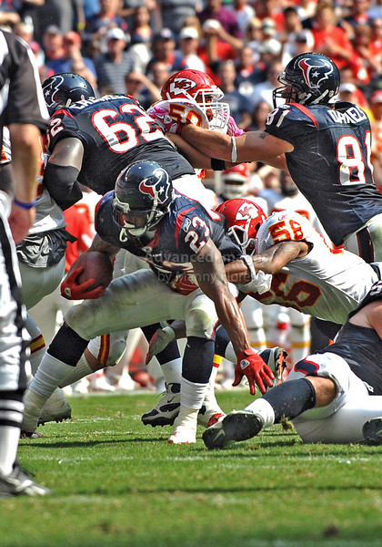 17 Oct 2010:  <br /> Houston Texans running back Arian Foster #23 carries the ball as he is tackled by Kansas City Chiefs linebacker Derrick Johnson #56<br /> in a game between the Kansas City Chiefs and the Houston Texans at Reliant Stadium in Houston, Texas.<br /> Houston wins 35-31