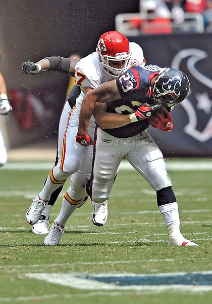 17 Oct 2010:  <br /> Houston Texans running back Arian Foster #23 carries the ball and is tackled by Kansas City Chiefs safety Jon McGraw #47<br /> in a game between the Kansas City Chiefs and the Houston Texans at Reliant Stadium in Houston, Texas.<br /> Houston wins 35-31