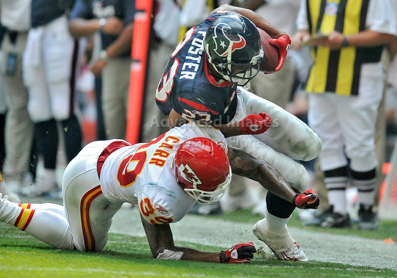 Oct 17 2010:  <br /> Houston Texans running back Arian Foster #23 is tripped up by Kansas City Chiefs cornerback Brandon Carr #39 in a game between Kansas City Chiefs and the Houston Texans at Reliant Stadium in Houston, Texas.<br /> Houston wins 35-31<br /> (Credit Image: © Manny Flores/Cal Sport Media)
