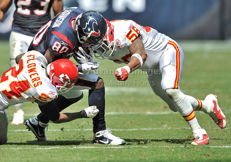Oct 17 2010:  <br /> Houston Texans wide receiver Andre Johnson #80 catches the ball for a big gain as he is tackled by Kansas City Chiefs linebacker Derrick Johnson #56 and Kansas City Chiefs cornerback Brandon Flowers #24 in a game between Kansas City Chiefs and the Houston Texans at Reliant Stadium in Houston, Texas.<br /> Houston wins 35-31<br /> (Credit Image: © Manny Flores/Cal Sport Media)