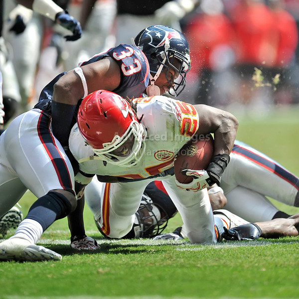 Oct 17 2010:  <br /> Kansas City Chiefs running back Jamaal Charles #25 carries the ball as he is tackled by Houston Texans safety Troy Nolan #33 in a game between Kansas City Chiefs and the Houston Texans at Reliant Stadium in Houston, Texas.<br /> Houston wins 35-31<br /> (Credit Image: © Manny Flores/Cal Sport Media)