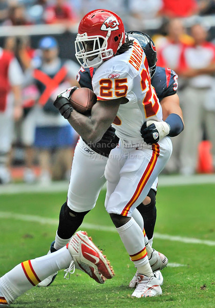 Oct 17 2010:  <br /> Kansas City Chiefs running back Jamaal Charles #25 tries to get by Houston Texans defensive tackle Shaun Cody #95 in a game between Kansas City Chiefs and the Houston Texans at Reliant Stadium in Houston, Texas.<br /> Houston wins 35-31<br /> (Credit Image: © Manny Flores/Cal Sport Media)